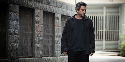 Alexandre Nero interpreta o fotógrafo Simão