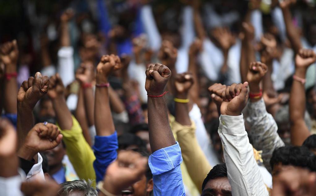 Membros da Comunidade Dalit, a mais marginalizados da Índia, protestam em Nova Deli.