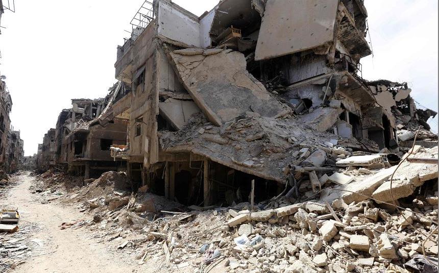 Escombros em Rama, no acampamento de refugiados palestinos de Yarmuk, na periferia sul da capital Síria de Damasco.